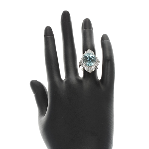 47 - Large impressive platinum dress ring set with fine quality oval aquamarine 8.99ct, in a surround of ...