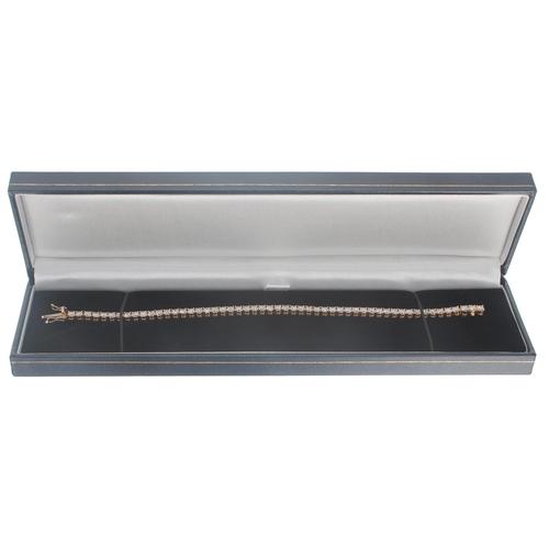 58 - Good modern 18ct rose gold diamond line bracelet, round brilliant-cuts, estimated7.28ct in total, c...
