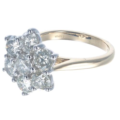 59 - Good 18ct white and yellow gold seven stone diamond daisy cluster ring, round brilliant-cut estimate...