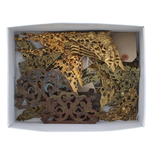 1466 - Ten sets of pierced brass spandrels; also a set of 18th century pierced brass lantern frets...