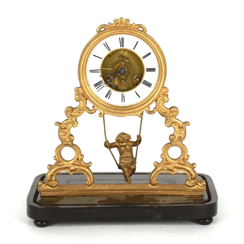 """Frenchgilt metal two train cherub swinging mantel clock, the movement with outside countwheel striking on a bell, the 4"""" white chapter ring enclosing a skeletonised centre over a swinging pendulum cherub and foliate pierced supports, 11.75"""" high (dome missing)"""