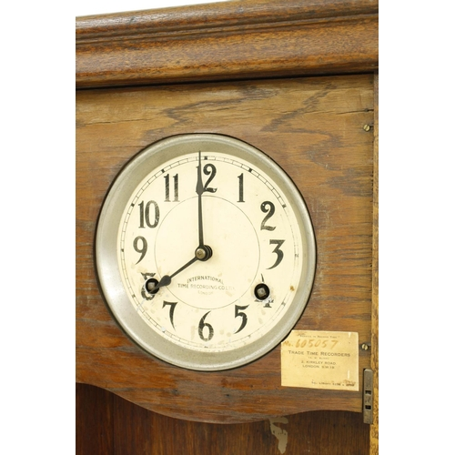 1419 - International Time Recording Co. Limited of London time recorder, within an oak glazed case, 39.75