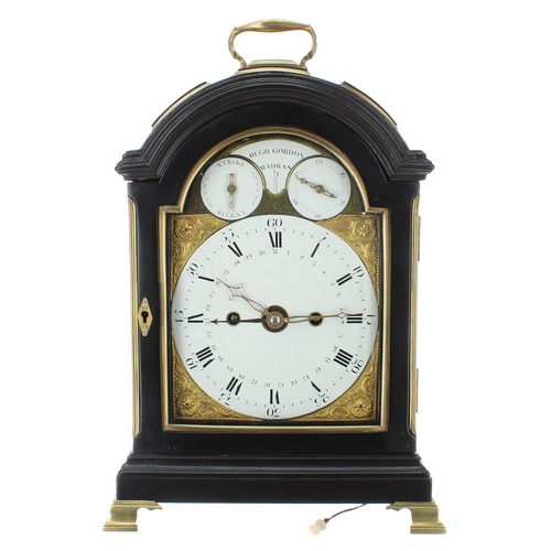 """Fine English ebonised double fusee calendar pad top bracket clock, signed Hugh Gordon, Madras on an arched plate above the dial and flanked by subsidiary strike/silent and seconds dials, over the principal dial with calendar chapter ring, the movement with pull repeat, foliate engraved back plate and locking pendulum, within a stepped rounded arched case surmounted by an ormolu handle, 15"""" high (pendulum and keys)"""