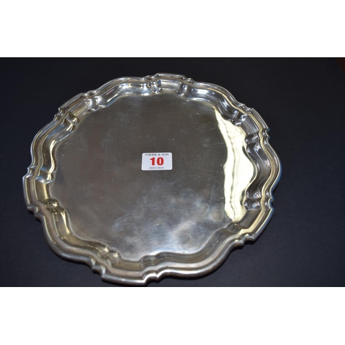 10 - A silver salver, by Charles S Green & Co Ltd, Birmingham 1919, having pie crust border, 25.5cm, 431g...