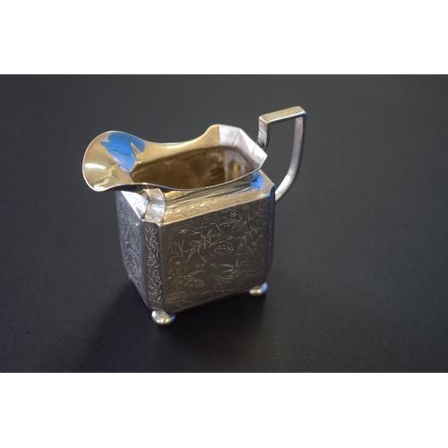 16 - A Victorian silver rectangular cream jug, by William Hutton & Sons, London 1879, 7cm, 84g....