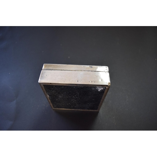24 - An engine turned silver square cigarette box and a similar silver photograph frame....