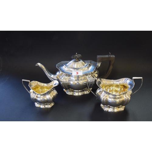 3 - An Edwardian silver three piece tea set, by William Aitken, Birmingham 1904; together with a similar...