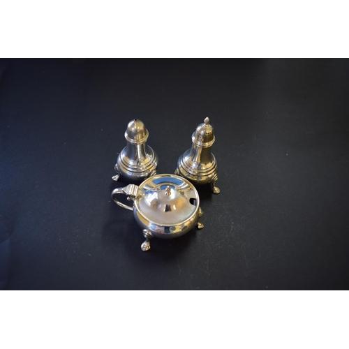35 - A silver three piece condiment set, by Edward Barnard & Sons Ltd, London 1931/3, 171g....