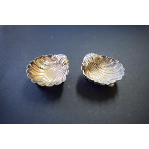 39 - A pair of silver shell salts; together with a pierced silver bonbon dish; and a toddy ladle bowl....