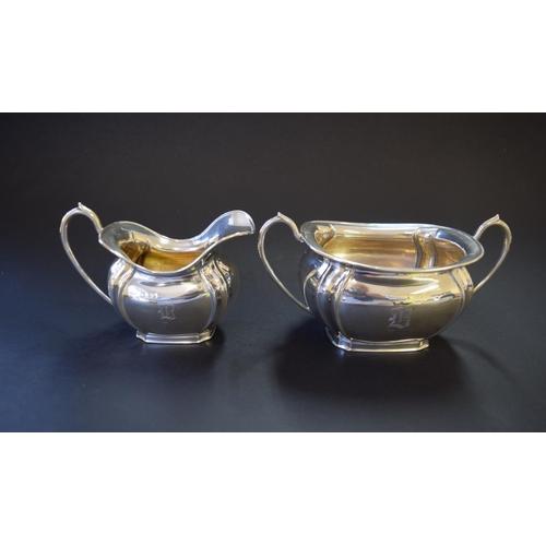4 - An Edwardian silver bachelor's three piece tea set, by John Round & Sons Ltd, Sheffield 1909/1910, 6...