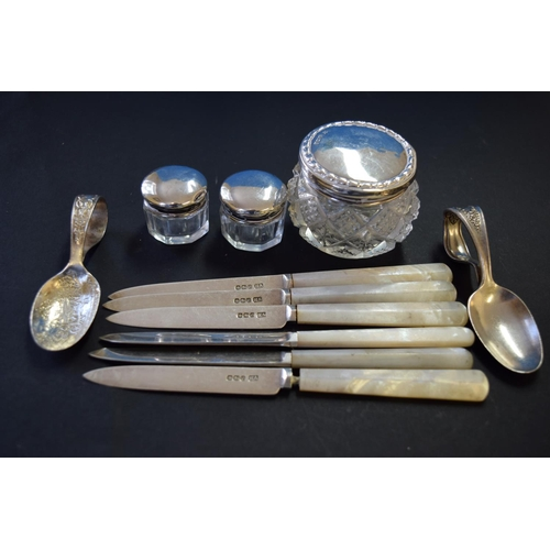 42 - A small quantity of silver items, comprising: a set of six silver bladed and mother of pearl handled...