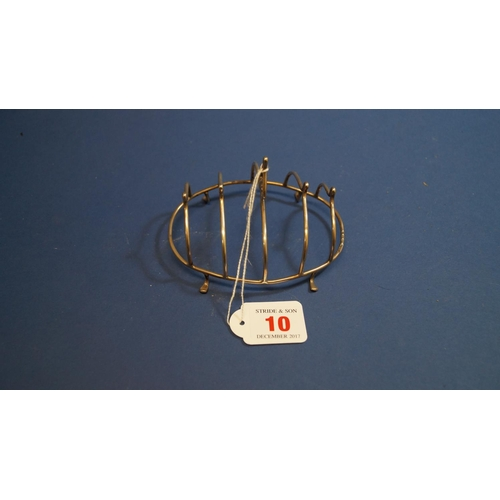 10 - A silver oval four division toast rack, by S Blackensee & Sons Ltd, Birmingham 1923, 11cm, 47g....