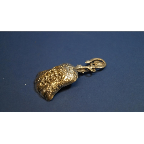 19 - A unmarked caddy spoon, having floral decoration and gilded bowl, 8cm....