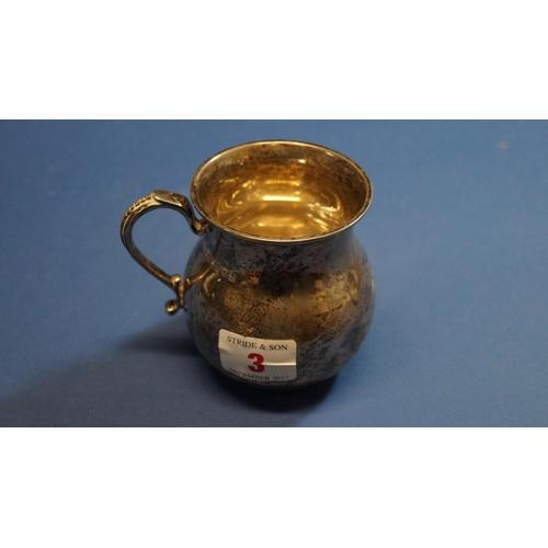 3 - A bulbous silver Christening mug, by Reid & Sons of Newcastle, London 1923, 8.5cm, 161g....