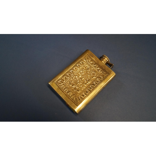 4 - A metal hip flask having chased decoration, 13cm....