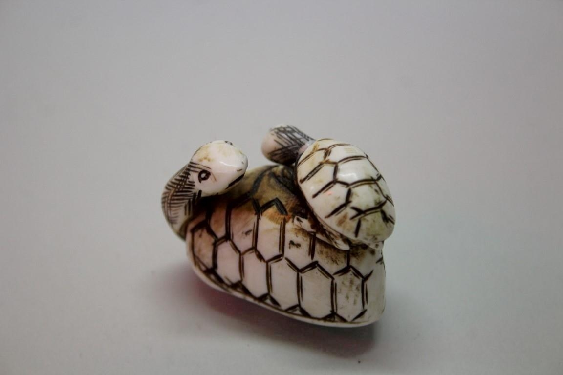 A Japanese Carved Bone Or Ivory Netsuke Of Two Tortoises Signed 4 2cm Long Together With A Japane