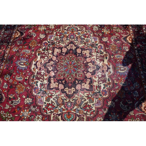 1188 - <strong>A Persian rug,</strong> having allover floral decoration with large floral medallion to cent...