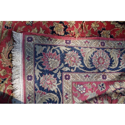 1189 - <strong>A Persian rug,</strong> having allover floral decorations, the centre decorated with stag an...