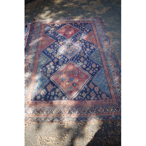 1191 - <strong>A Persian rug,</strong> having three central medallions and allover floral and geometric des...