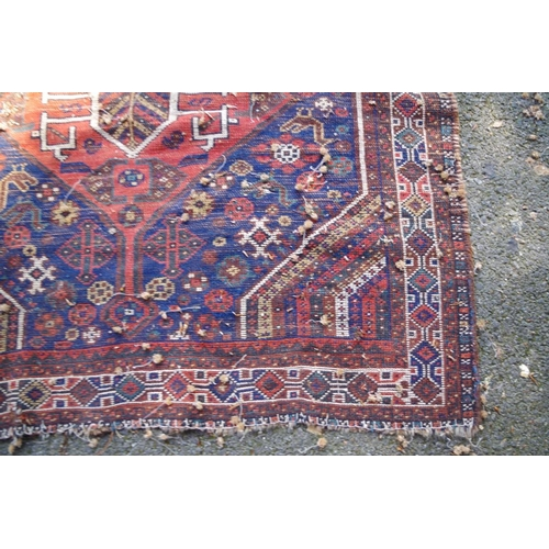 1192 - <strong>An Afghan rug,</strong> having floral decoration to centre with bird motifs and two central ...