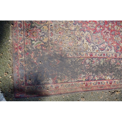 1193 - <strong>A large Persian rug,</strong> having large floral medallion and allover floral decoration, 3...