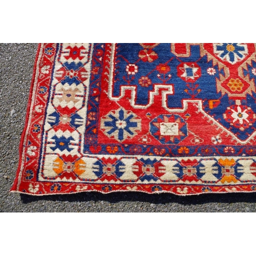 1198 - <strong>A North West Persian rug,</strong> having geometric design with floral field and borders, 20...