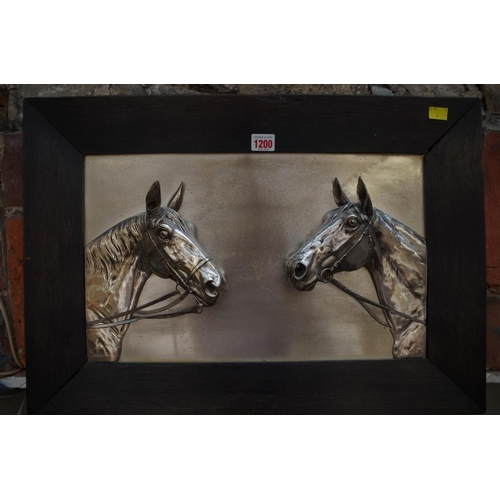 1200 - <strong>An electroplated plaque of two horse heads,</strong>28 x 46cm, framed....
