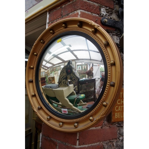 1204 - <strong>A Regency style convex mirror,</strong> 52cm diameter....