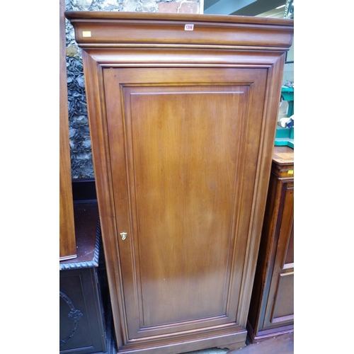 1206 - <strong>A contemporary cherry wood wardrobe,</strong> 90cm wide....