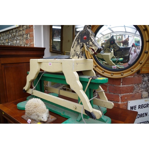 1207 - <strong>A small painted wood rocking horse,&nbsp;</strong>90cm long.&nbsp;...