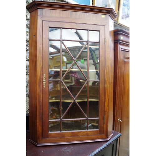 1212 - <strong>A George III mahogany hanging corner cupboard,&nbsp;</strong>79cm wide.&nbsp;...