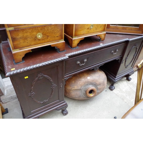 1213 - <strong>An early 20th century mahogany inverted breakfront pedestal sideboard,&nbsp;</strong>198cm w...