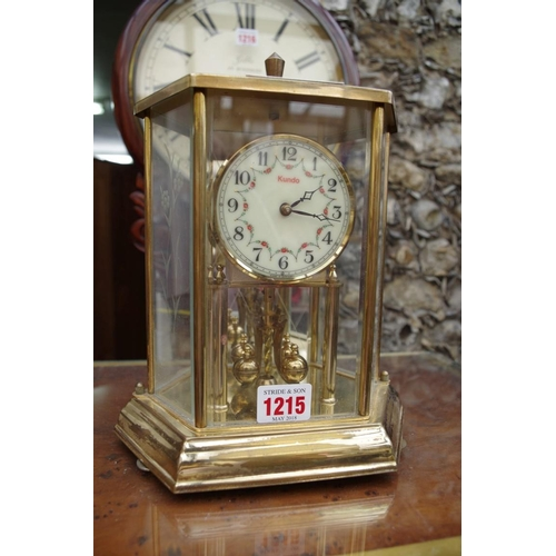 1215 - <strong>A Kundo anniversary clock,</strong> 25cm high....