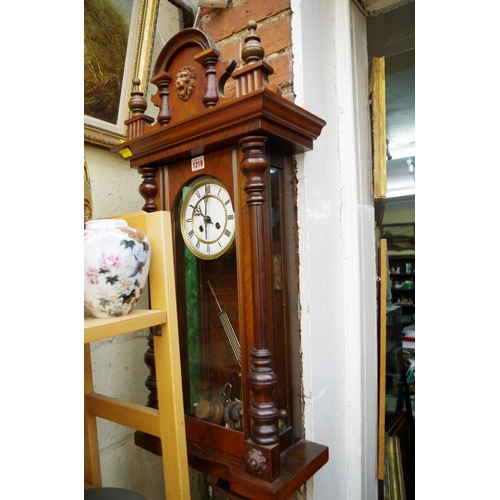 1219 - <strong>A late 19th century walnut Vienna style wall clock.</strong>...