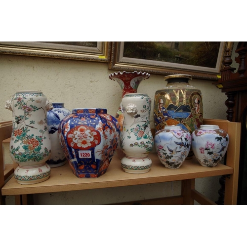 1220 - <strong>A collection of Japanese pottery and porcelain jars and vases. </strong>...