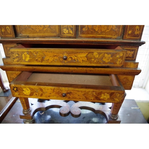 1762 - <strong>An 18th century Dutch marquetry small cabinet, </strong>57cm wide....