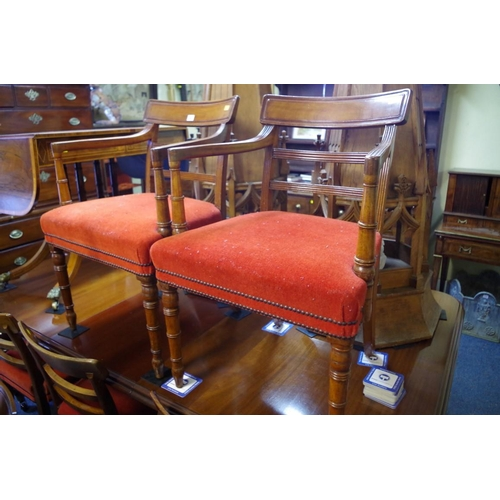 1801 - <strong>A set of twelve George IV mahogany bar back dining chairs, </strong>to include a pair of elb...