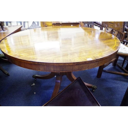 1809 - <strong>An early 19th century rosewood and satinwood banded circular tilt-top breakfast table,&nbsp;...