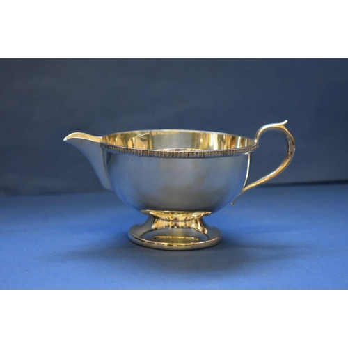 1 - <strong>A silver three piece teaset, </strong><em>by E H P Co Ltd,</em> Sheffield 1964, 884g all in....