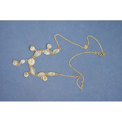 100 - <strong>An Edwardian moonstone necklace,</strong>on an unmarked fine gold chain....