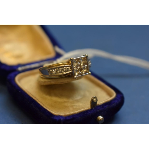 103 - <strong>An 18ct yellow gold Princess cut diamond ring&nbsp;</strong>of&nbsp;four square set stones a...