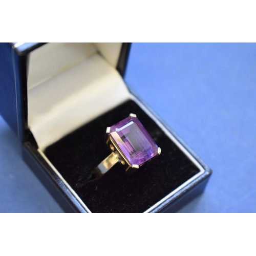 104 - <strong>A 14k gold ring set square cut amethyst.</strong>...