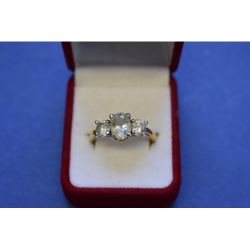 106 - <strong>An 18ct gold gem set dress ring;</strong> together with a 9ct gold cluster ring; and an unma...
