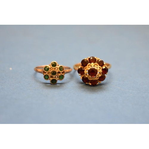 107 - <strong>An 18ct gold and garnet dress ring;&nbsp;</strong>together with an 18ct gold diamond half et...