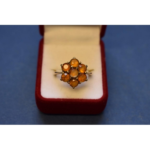 109 - <strong>Three dress rings;</strong> Two topaz rings mounted in unmarked yellow gold; together with a...