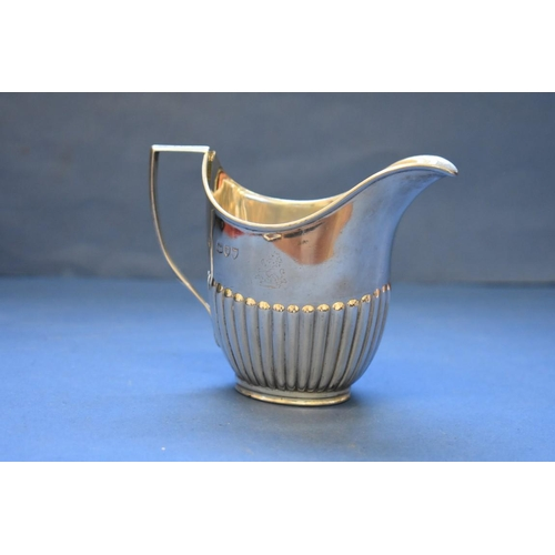 11 - <strong>A Victorian silver creamer, </strong><em>by W Hutton &amp; Sons Ltd, </em>London 1894, indis...