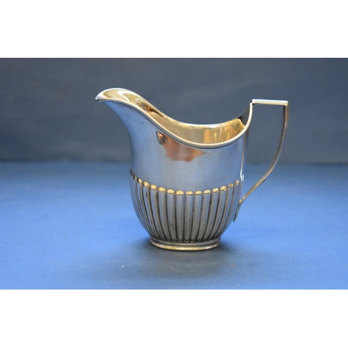 11 - <strong>A Victorian silver creamer, </strong><em>by W Hutton &amp; Sons Ltd,</em>London 1894, indis...