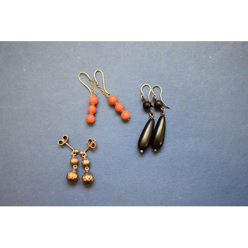 116 - <strong>A pair of coral bead drop earrings</strong>; together with a pair of 9ct gold examples; and ...