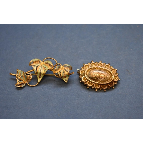 119 - <strong>An unmarked Art Nouveau pendant set orange topaz;&nbsp;</strong>together with an 18ct gold c...
