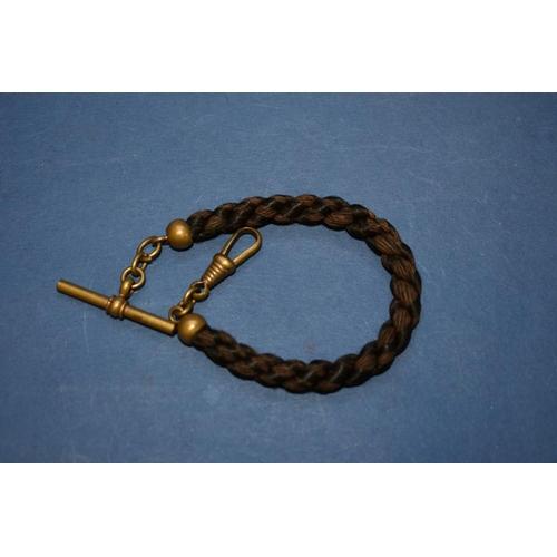121 - <strong>A memento mori rope twist hair Albert</strong>, having base metal fittings.19cm....